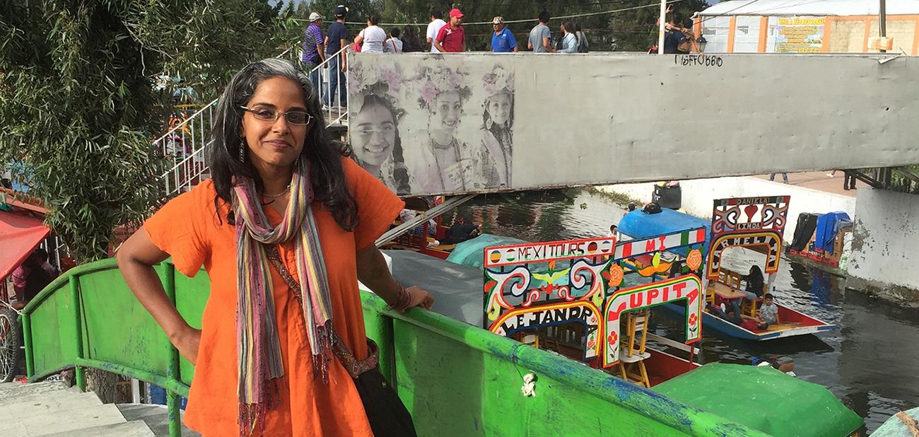 Anu Taranath standing on a bridge in Mexico