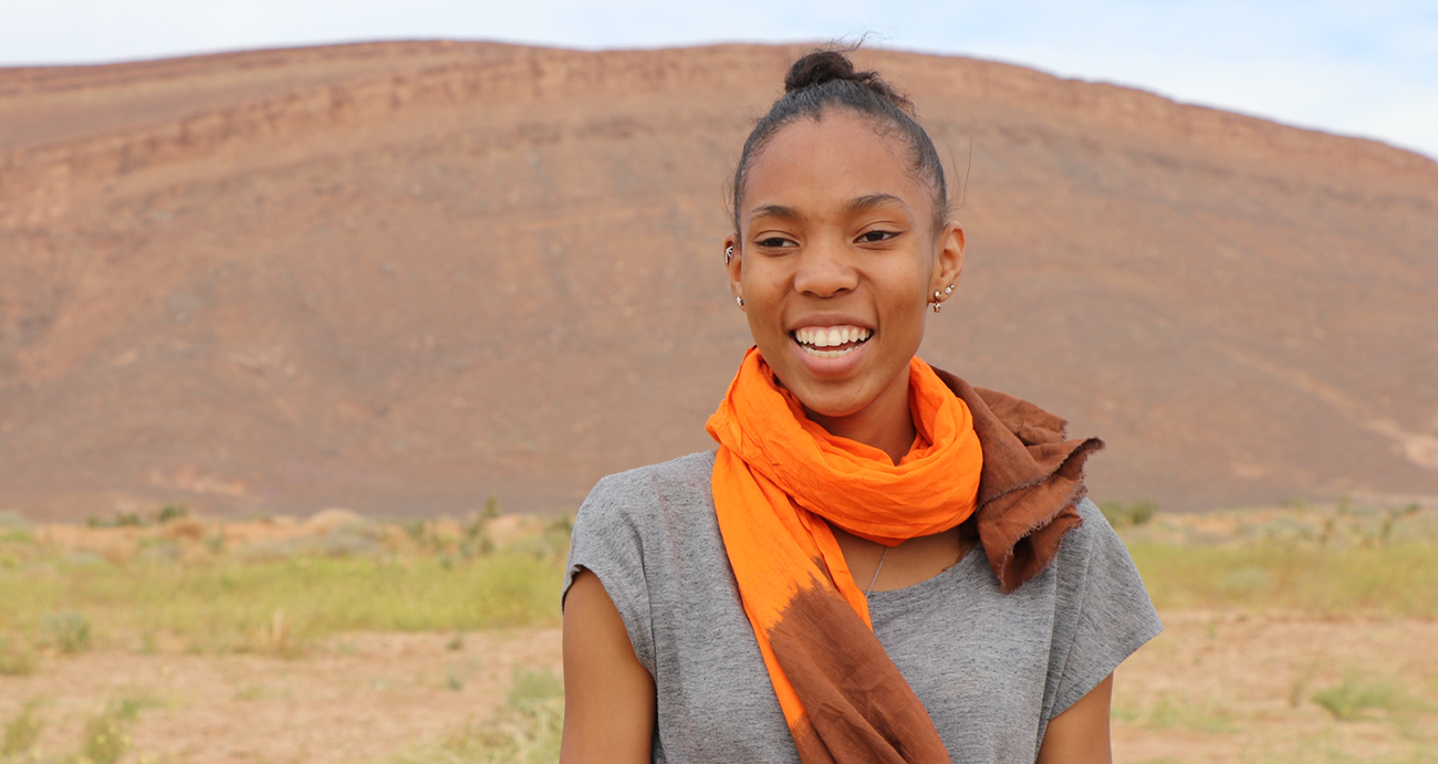 Deja Edwards with a Moroccan landscape behind her.
