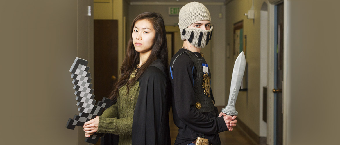 A medieval knight and soldier pose with swords--in UW's Smith Hall..