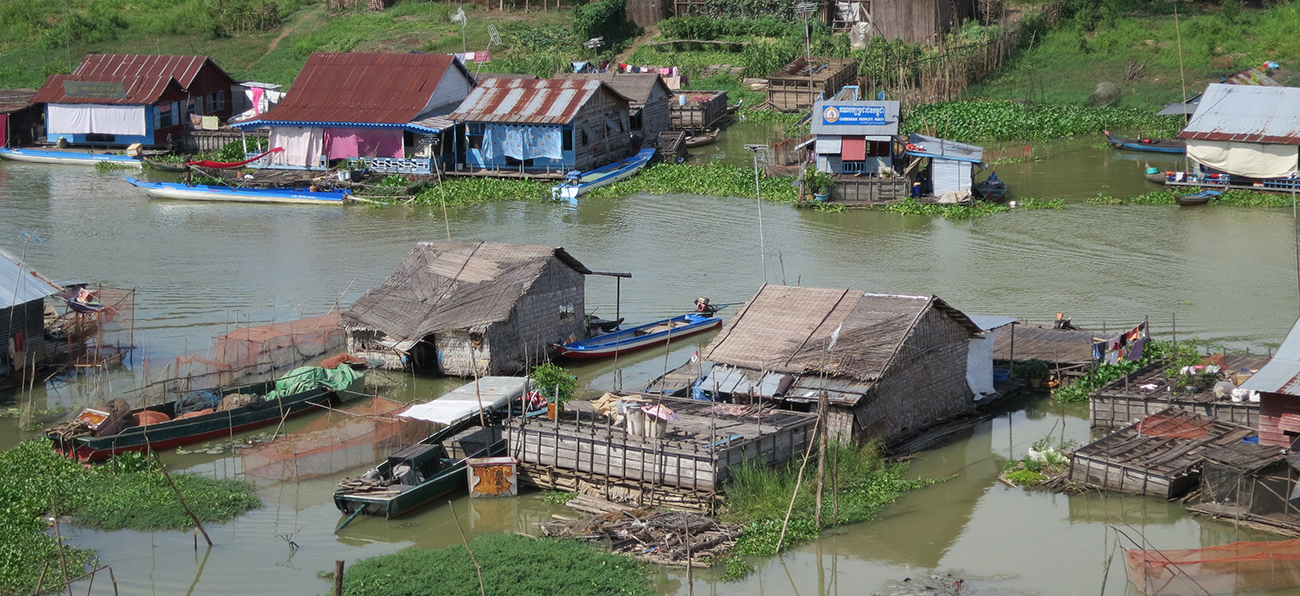 Houses in water, on both sides of a river in Cambodia