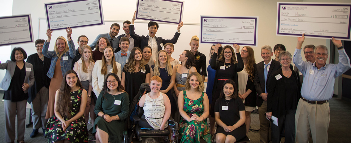Students in the Social Justice Through Philanthropy class gather for a photo with the award recipients.