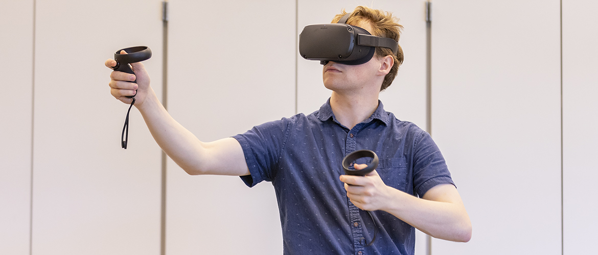 Jared Canright wearing an immersive headset to test an experiment.