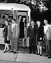 Drama students prepare to board a bus.