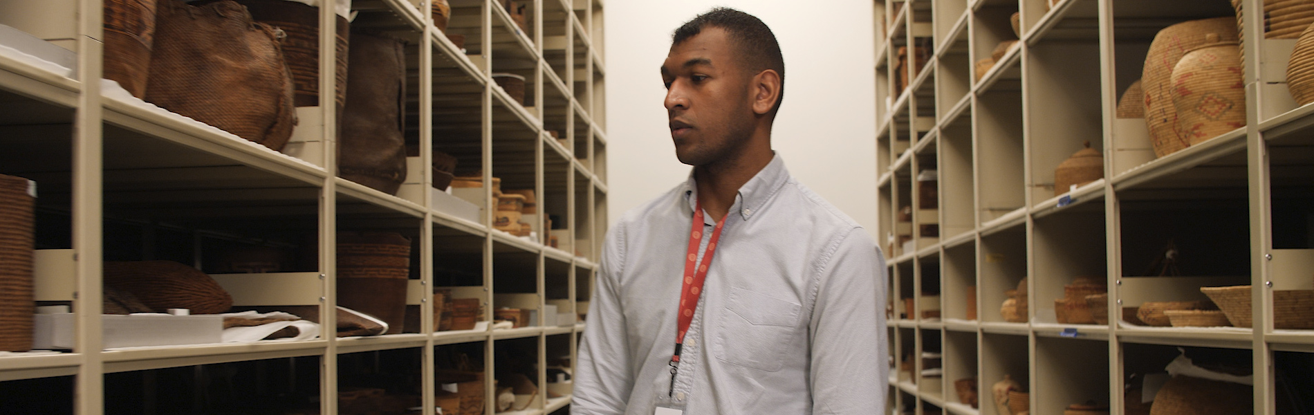 Student looking through shelves of historical items and documents