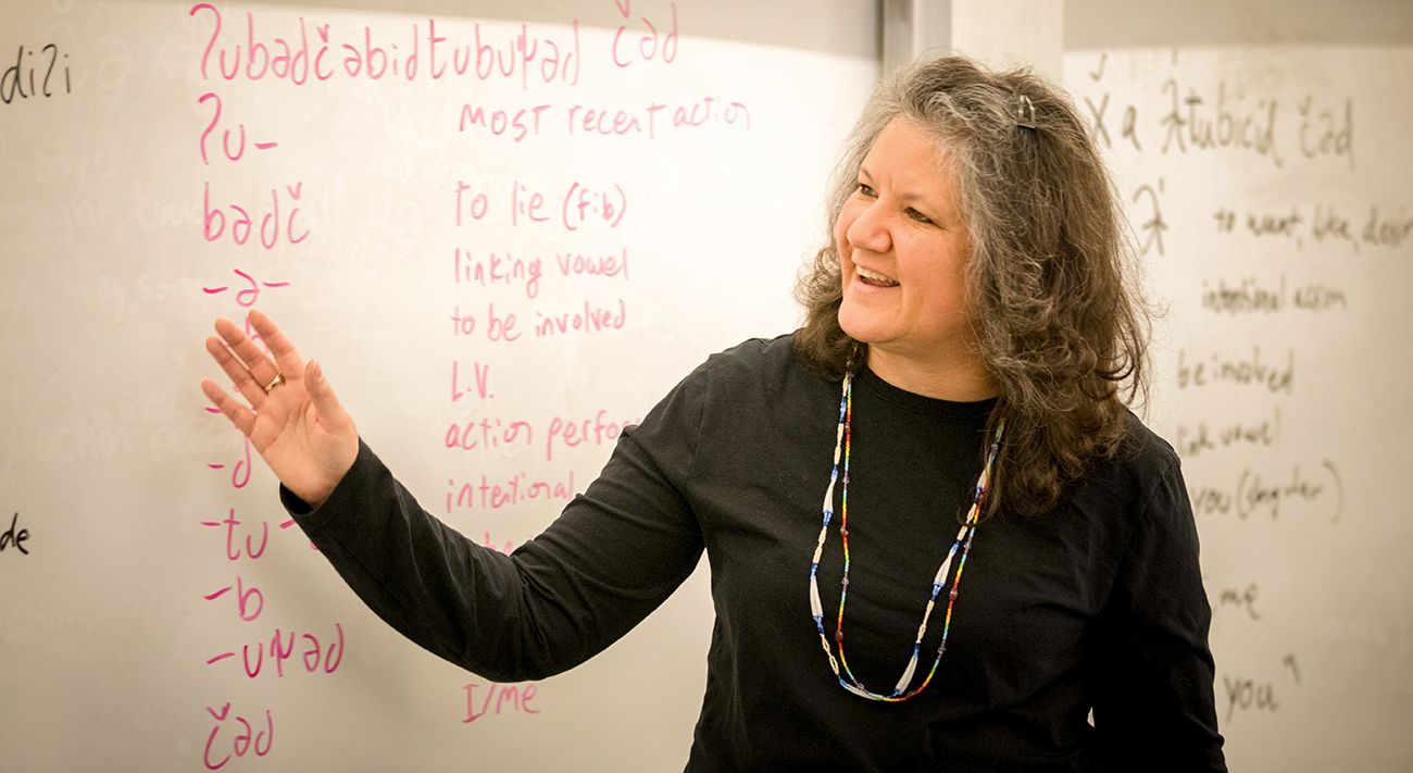Tami Hohn at white board, teaching Southern Lushootseed