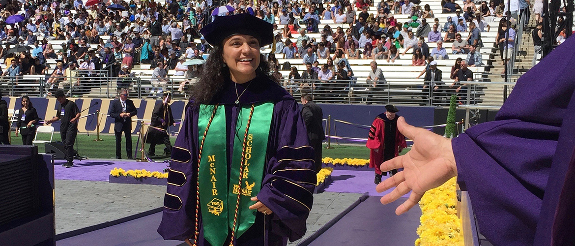 Yolanda Valencia at UW commencement, receiving her PhD.